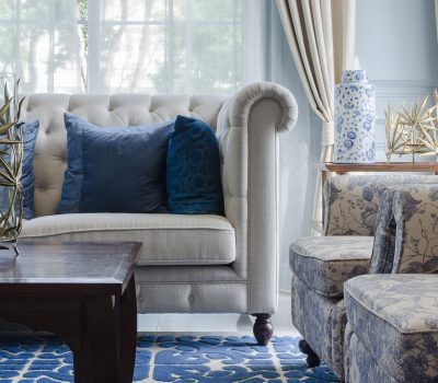 34873753 - luxury living room with sofa on blue pattern carpet